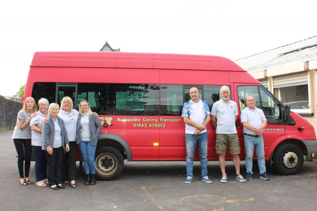 Some of our staff team standing in front of an ACT Bus